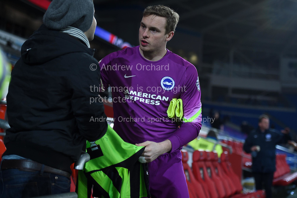 goalkeeper David Stockdale of Brighton signs a fans shirt at end of the match. Skybet football league championship match, Cardiff city v Brighton &amp; Hove Albion at the Cardiff city Stadium in Cardiff, South Wales on Tuesday 10th Feb 2015.<br /> pic by Andrew Orchard, Andrew Orchard sports photography.