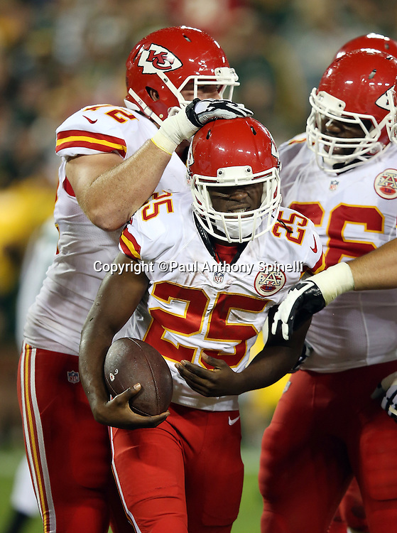 Kansas City Chiefs running back Jamaal Charles (25) celebrates with teammates after running for a 9 yard second quarter touchdown that cuts the Green Bay Packers lead to 17-7 during the 2015 NFL week 3 regular season football game against the Green Bay Packers on Monday, Sept. 28, 2015 in Green Bay, Wis. The Packers won the game 38-28. (©Paul Anthony Spinelli)