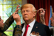 UNITED KINGDOM, London: 18 January 2017 The wax figure of President Elect Donald J. Trump gets the final touches by Jemma Sim(left) and Chris Gargiulo (right) in the Madame Tussauds London's Oval Office section at its unveiling today. The London wax figure is one of four Trump figures created by Madame Tussauds globally, the others are in Washington D.C, New York and Orlando. Rick Findler / Story Picture Agency