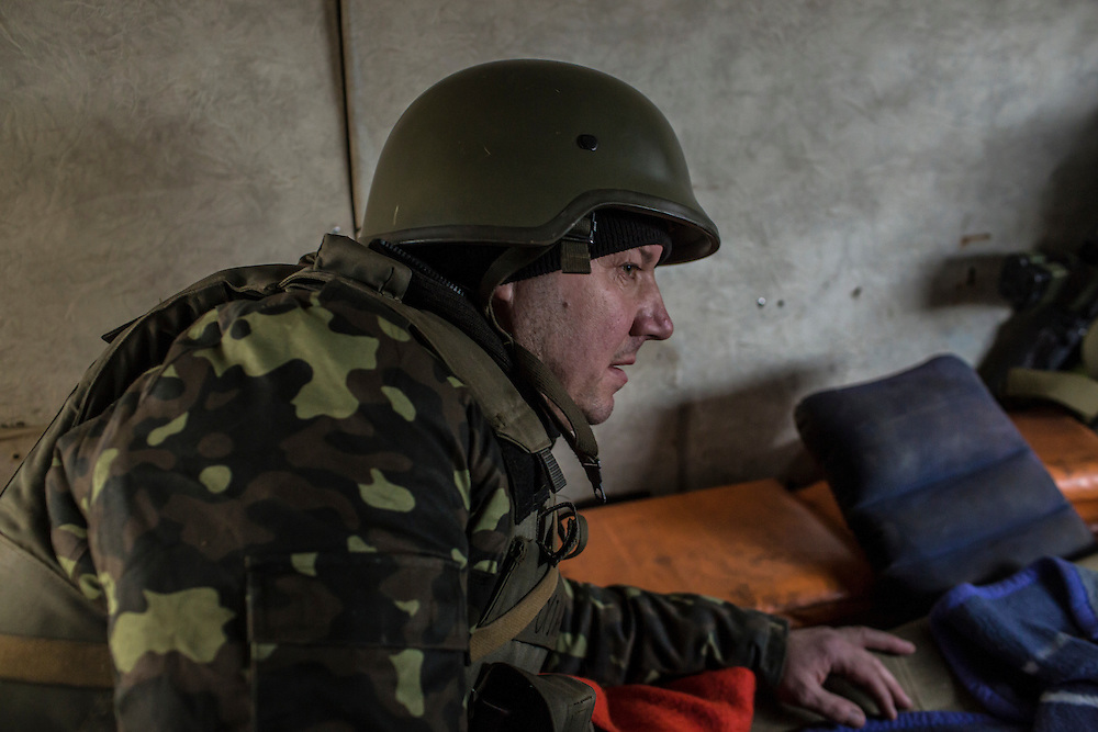 DEBALTSEVE, UKRAINE - FEBRUARY 8, 2015: A Ukrainian Army medic rides out of the front-line town of Debaltseve in the back of an ambulance in Debaltseve, Ukraine. Fighting between pro-Russia rebels and Ukrainian forces there over the past two weeks has dealt steady casualties to Ukrainian fighters and civilians. CREDIT: Brendan Hoffman for The New York Times
