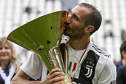 May 19, 2018 - Turin, Italy - Juventus defender Giorgio Chiellini (3) kisses the Serie A soccer title trophy after the Serie A football match n.38 JUVENTUS - VERONA on 19/05/2018 at the Allianz Stadium in Turin, Italy. (Credit Image: © Matteo Bottanelli/NurPhoto via ZUMA Press)