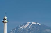 Africa. Tanzania. Moshi. Mt Kilimanjaro..Islamic mosque tower in foreground..CD0011