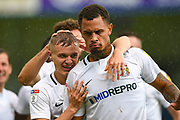 Coventry City forward Jonson Clarke-Harris (18) (right) celebrates with team mates after scoring a goal (0-1) between Gillingham and Coventry City at the MEMS Priestfield Stadium, Gillingham, England on 25 August 2018.