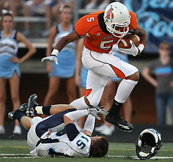 Laporte's Aaaron Nance-Garrett (5) bowls over Clements' Brad Fontana for a thirty-six-yard reception early in the second quarter of their season-opening matchup, Friday, August 27, 2010 at Bulldog Stadium in Laporte, TX.