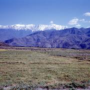Late Summer? 1965<br /> Barren fields. Barren mountains. Snowy mountains.