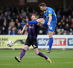 AFC Wimbledon's Darren Jones challenges Bristol Rovers' Matt Harrold to the ball - Photo mandatory by-line: Dougie Allward/JMP - Mobile: 07966 386802 05/04/2014 - SPORT - FOOTBALL - Kingston upon Thames - Kingsmeadow - AFC Wimbledon v Bristol Rovers - Sky Bet League Two
