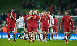 DUBLIN, IRELAND - Tuesday, February 8, 2011: Wales' Andrew Crofts looks dejected as he applauds the travelling supporters after losing 3-0 to the Republic of Ireland during the opening Carling Nations Cup match at the Aviva Stadium (Lansdowne Road). (Photo by David Rawcliffe/Propaganda)