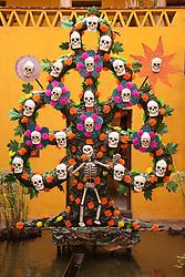 North America, Mexico, Oaxaca Province, Oaxaca, elaborate skull and flower sculpture in courtyard, Day of the Dead (Dias de los Muertos) celebration
