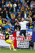 Bolton's Gary Madine  outjumps Joe Skarz  during the EFL Sky Bet League 1 match between Bolton Wanderers and Oxford United at the Macron Stadium, Bolton, England on 1 October 2016. Photo by Craig Galloway.