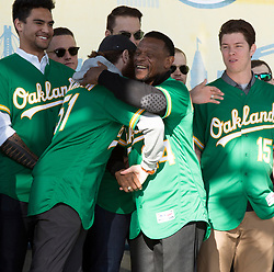 Oakland Athletics Hall of Famer Rickey Henderson (24) hugs A's broadcaster and former pitcher Dallas Braden during introductions at A's FanFest at Jack London Square on Saturday, Jan. 27, 2018 in Oakland, Calif. (D. Ross Cameron/SF Chronicle)