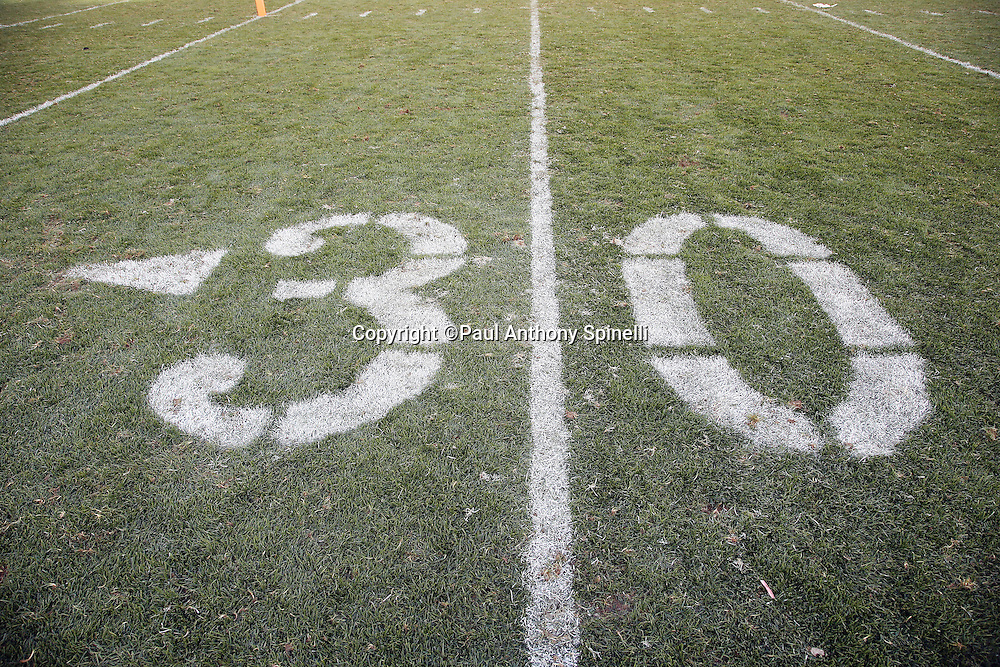 The 50 yard line marker that is painted on the grass is chewed up with fleet marks after the Pittsburgh Steelers 2015 NFL week 6 regular season football game against the Arizona Cardinals on Sunday, Oct. 18, 2015 in Pittsburgh. The Steelers won the game 25-13. (©Paul Anthony Spinelli)