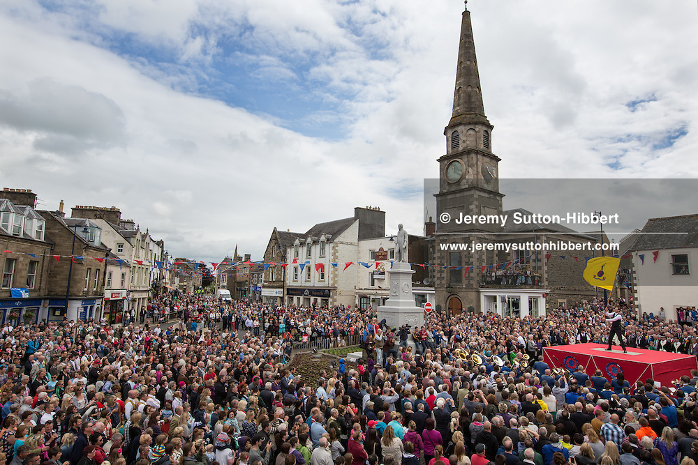 The Casting of the Colours ceremony, where the town's associations flags are waved in spectacular fashion in front of large crowds, led by Royal Burgh Standard Bearer Martin Rodgerson and his Burleymen, during the Common Riding festivities in Selkirk, in Selkirk, Scotland, Friday 14th June 2013. <br /> N55&deg;32.820'<br /> W2&deg;50.512'
