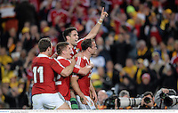 6 July 2013; Jamie Roberts, British & Irish Lions, right, celebrates with team-mates, from right, Conor Murray, Owen Farrell and George North after scoring his side's fourth try. British & Irish Lions Tour 2013, 3rd Test, Australia v British & Irish Lions. ANZ Stadium, Sydney Olympic Park, Sydney, Australia. Picture credit: Stephen McCarthy / SPORTSFILE