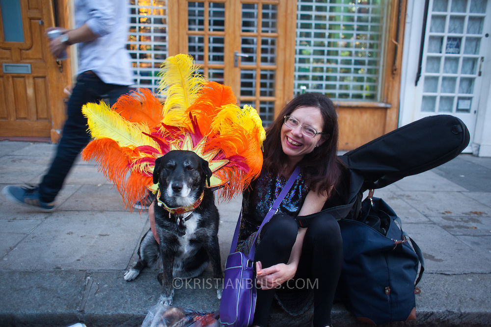 A woman and her carnival dog in Portobello Road.The Notting Hill Carnival has been running since 1966 and is every year attended by up to a million people. The carnival is a mix of amazing dance parades and street parties with a distinct Caribbean feel.