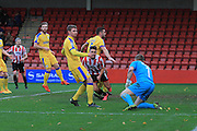 Billy Waters scores and celebrates his goal during the Vanarama National League match between Cheltenham Town and Chester City at Whaddon Road, Cheltenham, England on 5 December 2015. Photo by Antony Thompson.