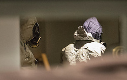 © Licensed to London News Pictures. 06/03/2018. Salisbury, UK. Police in protective suits and gas masks are seen inside Zizzi's restaurant in Salisbury, Wiltshire, where former Russian spy Sergei Skripal and his daughter visited before becoming ill with suspected poisoning. The couple where found unconscious on bench in Salisbury shopping centre. Specialist units have been called in to deal with any possible contamination. Photo credit: Peter Macdiarmid/LNP