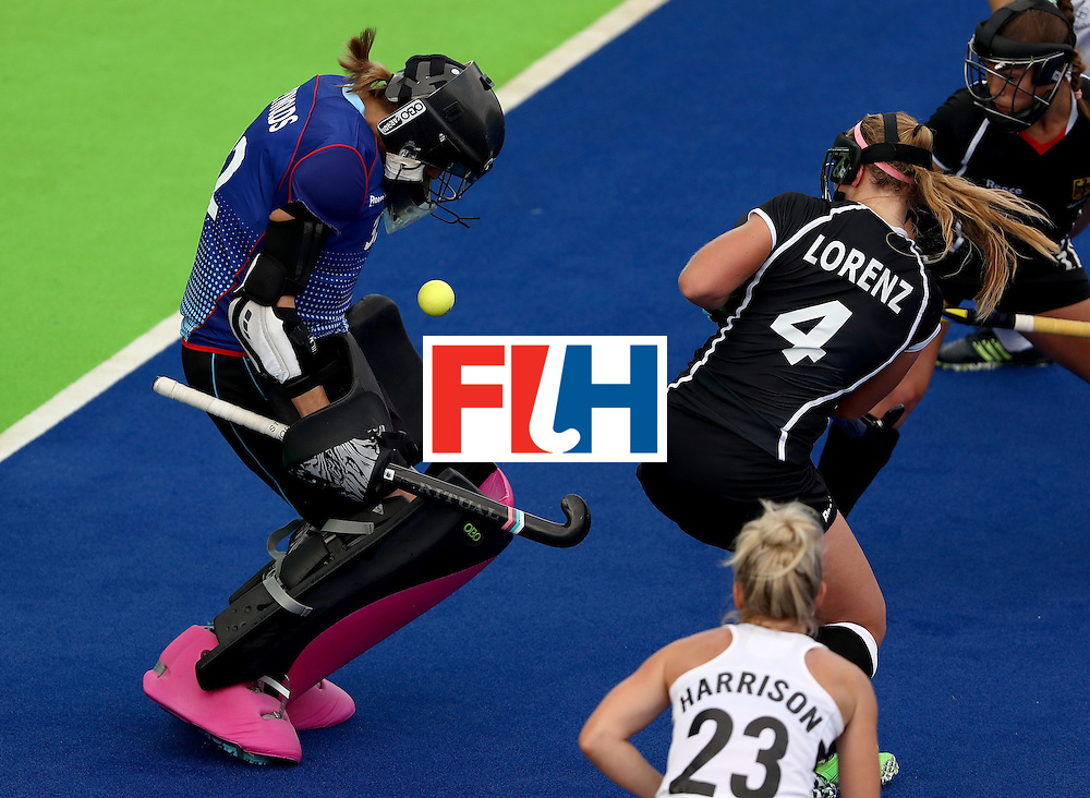 RIO DE JANEIRO, BRAZIL - AUGUST 08:  Kristina Reynolds #32 of Germany and Nike Lorenz #4 of Germany defend against a shot on goal by New Zealand  during a Women's Pool A match on Day 3 of the Rio 2016 Olympic Games at the Olympic Hockey Centre on August 8, 2016 in Rio de Janeiro, Brazil.  (Photo by Sean M. Haffey/Getty Images)
