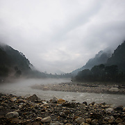 The Bhagirathi (Ganges) River flows through early morning fog above Uttarkashi, Uttarakhand, India.