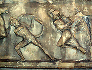 An Amazon facing backwards on her horse and shooting with her bow; a Greek defending himself against an Amazon armed with an axe.