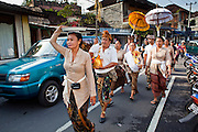 "Apr 24 - UBUD, BALI, INDONESIA: A religious procession on ""Monkey Forest Road"" in Ubud, Bali. Photo by Jack Kurtz/ZUMA Press"