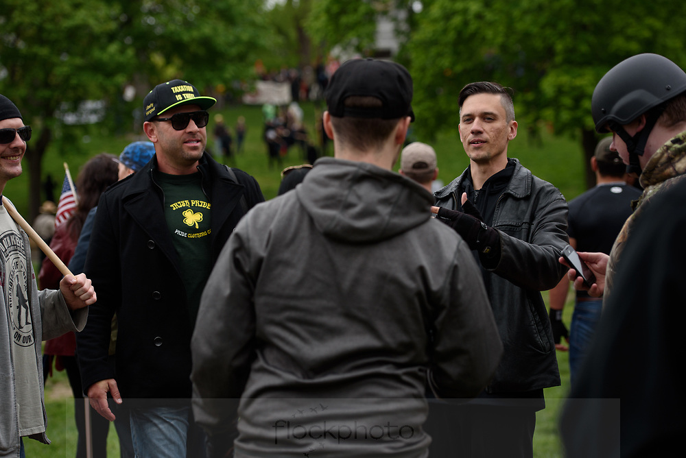 Leaders in the alt-right movement, Kyle Chapman, known as &quot;Based Stickman&quot; (l) and Augustus Sol Invictus, a Republican attorney who has stated belief in the philosophy of eugenics, greet supporters during a rally on Boston Common, May 13, 2017.<br /> Photo / Kate Flock