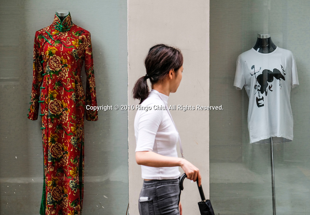 A woman walks by a gallery at the M50 Art Colony in Shanghai, China. Shanghai is the most populous city in China and the most populous city proper in the world. It is one of the four direct-controlled municipalities of China, with a population of more than 24 million as of 2014. It is a global financial centre, and a transport hub with the world's busiest container port. Located in the Yangtze River Delta in East China, Shanghai sits on the south edge of the mouth of the Yangtze in the middle portion of the Chinese coast. The municipality borders the provinces of Jiangsu and Zhejiang to the north, south and west, and is bounded to the east by the East China Sea. A major administrative, shipping, and trading town, Shanghai grew in importance in the 19th century due to trade and recognition of its favourable port location and economic potential. The city was one of five forced open to foreign trade following the British victory over China in the First Opium War while the subsequent 1842 Treaty of Nanking and 1844 Treaty of Whampoa allowed the establishment of the Shanghai International Settlement and the French Concession. The city then flourished as a center of commerce between China and other parts of the world (predominantly Western countries), and became the primary financial hub of the Asia-Pacific region in the 1930s. However, with the Communist Party takeover of the mainland in 1949, trade was limited to socialist countries, and the city's global influence declined. In the 1990s, the economic reforms introduced by Deng Xiaoping resulted in an intense re-development of the city, aiding the return of finance and foreign investment to the city. Shanghai has been described as the &quot;showpiece&quot; of the booming economy of mainland China; renowned for its Lujiazui skyline, museums and historic buildings, such as those along The Bund, the City God Temple and the Yu Garden.(Photo by Ringo Chiu/PHOTOFORMULA.com)<br /> <br /> Usage Notes: This content is intended for editorial use only.
