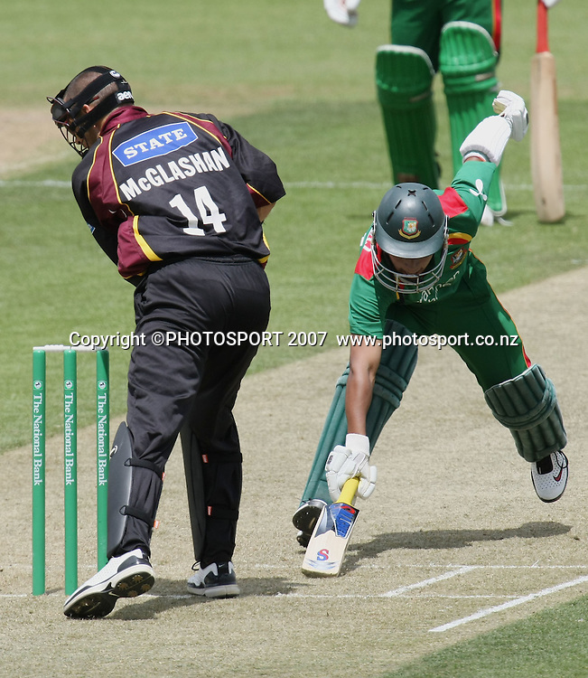 Knights wicketkeeper Peter McGlashan attempts a stumping of Mushfiqur Rahim. Northern Knights v Bangladesh. One day tour cricket match. Seddon Park, Hamilton. Sunday 16 December 2007. Photo: Stephen Barker/PHOTOSPORT