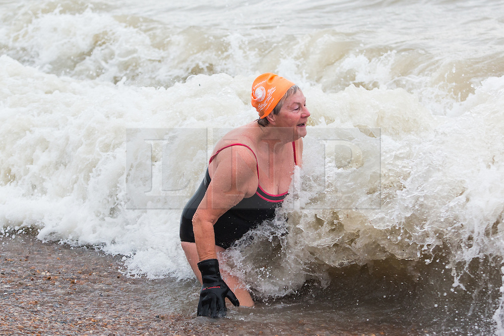 © Licensed to London News Pictures. 12/12//2015. Brighton, UK. Members of the Brighton and Hove Sea Swimming club brave the cold weather and take part in their daily exercise. Today December 12th 2015. Photo credit: Hugo Michiels/LNP