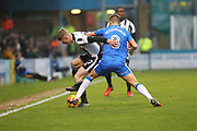 Andy Cannon and Jake Hessenthaler challenge for the ball during the EFL Sky Bet League 1 match between Gillingham and Rochdale at the MEMS Priestfield Stadium, Gillingham, England on 13 January 2018. Photo by Daniel Youngs.