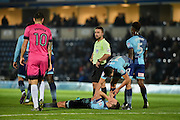 Wycombe Wanderers Midfielder, Matt Bloomfield (10) takes a knock to the head during the EFL Sky Bet League 2 match between Wycombe Wanderers and Hartlepool United at Adams Park, High Wycombe, England on 26 November 2016. Photo by Adam Rivers.