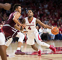 FAYETTEVILLE, AR - FEBRUARY 17:  Daryl Macon #4 of the Arkansas Razorbacks drives against Admon Gilder #3 of the Texas A&M Aggies at Bud Walton Arena on February 17, 2018 in Fayetteville, Arkansas.  The Razorbacks defeated the Aggies 94-75.(Photo by Wesley Hitt/Getty Images) *** Local Caption *** Daryl Macon; Admon Gilder