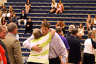 Northmont athletic director Robin Spiller gets a hug from K.J. Reider during the Greater Western Ohio Conference annual Collegiate Signing Recognition Ceremony at Fairmont High Schools Trent Arena in Kettering, Sunday, May 6, 2012.  Reider has signed to play football Redier at Notre Dame College.
