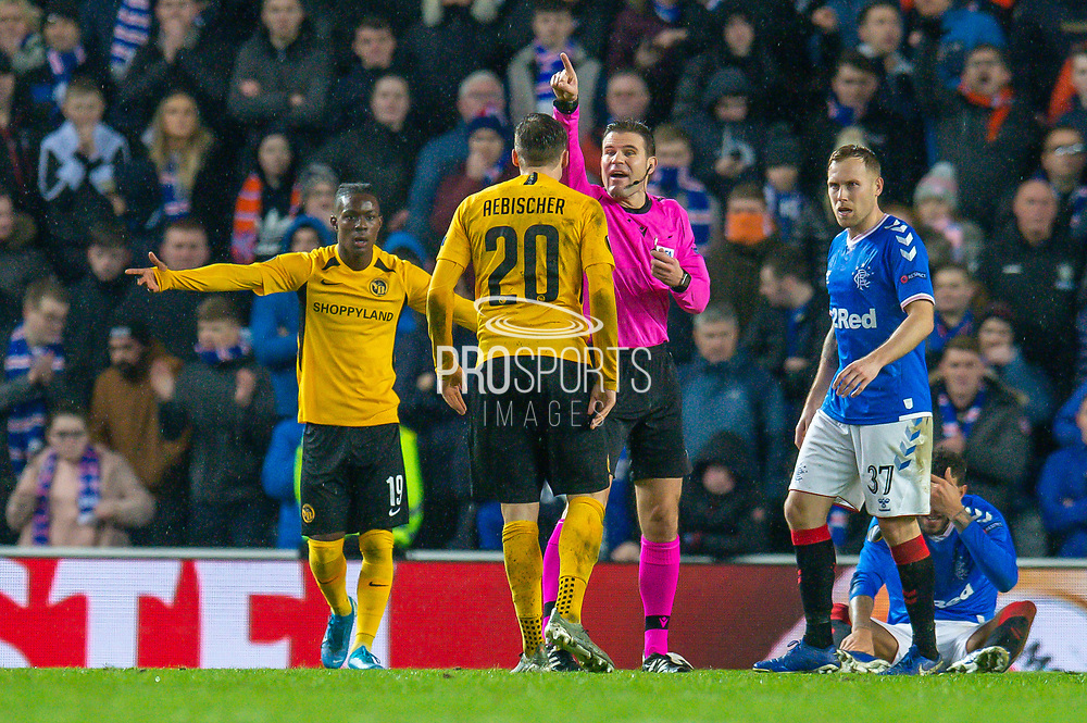 Referee Felix Brych (GER) speaks with Michel Aebischer (#20) of BSC Young Boys during the Europa League Group G match between Rangers FC and BSC Young Boys at Ibrox Park, Glasgow, Scotland on 12 December 2019.