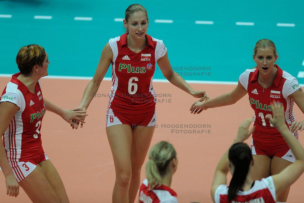 26-08-2010 VOLLEYBAL: WGP FINAL POLAND - BRAZIL: BEILUN NINGBO<br /> Brazil beat Poland 3-1 / Agnieszka Bednarek-Kasza, Anna Baranska and Karolina  Kosek<br /> &copy;2010-WWW.FOTOHOOGENDOORN.NL