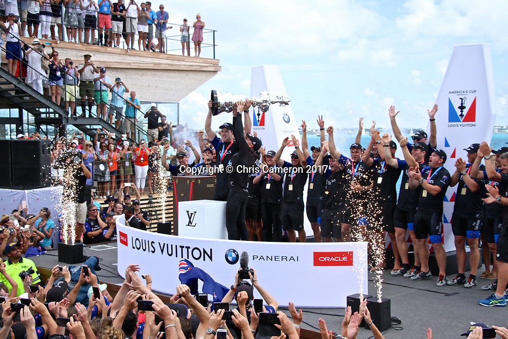 Peter Burling and Glenn Ashby raise the America's Cup - Emirates Team NZ wins the  America's Cup 2017, June 26, 2017 - Great Sound Bermuda. Photo: Richard Gladwell / www.photosport.nz