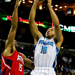 Jan 1, 2013; New Orleans, LA, USA; New Orleans Hornets shooting guard Eric Gordon (10) shoots over Atlanta Hawks center Al Horford (15) during the second quarter of a game at the New Orleans Arena. Mandatory Credit: Derick E. Hingle-USA TODAY Sports