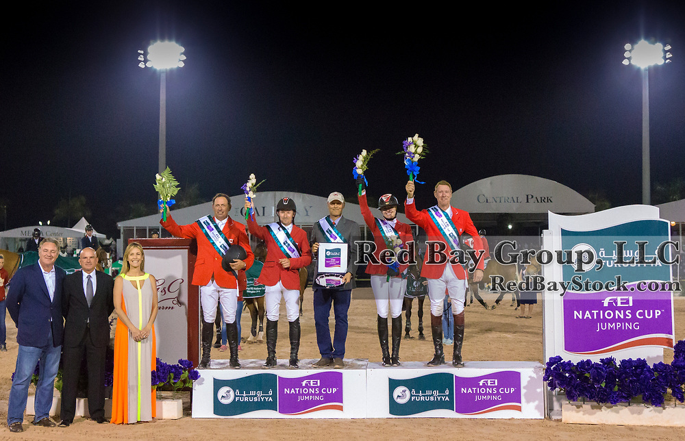 Yann Candele, Eric Lamaze, Tiffany Foster and Ian Millar, winning Canadian Team with their chef d'equipe, Mark Laskin at centre on the podium in the 2014 Furusiyya FEI Nations Cup held during the Winter Equestrian Festival in Wellington, Florida.