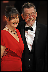 John Hurt, Ann Rees Meyers. arrives for the 2012 ORANGE BRITISH ACADEMY FILM AWARDS, The Bafta's at The Royal Opera House, Covent Garden, London. Photo By Andrew Parsons/ I-Images