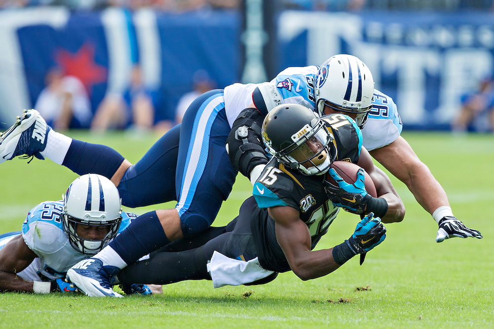 NASHVILLE, TN - OCTOBER 12:  Allen Robinson #15 of the Jacksonville Jaguars is tackled by Blidi Wreh-Wilson #25 of the Tennessee Titans at LP Field on October 12, 2014 in Nashville, Tennessee.  The Titans defeated the Jaguars 16-14.  (Photo by Wesley Hitt/Getty Images) *** Local Caption *** Allen Robinson; Blidi Wreh-Wilson
