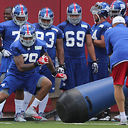Damontre Moore (left, 79), during a training routine during the 2013 New York Giants Training Camp at the Quest Diagnostics Training Centre, East Rutherford, New Jersey, USA. 29th July 2013. Photo Tim Clayton.