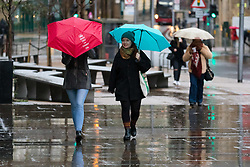 © Licensed to London News Pictures. 01/12/2018. London, UK.  People walking with umbrellas during rain and wet weather, near London Bridge on the first day of meteorological winter.  Photo credit: Vickie Flores/LNP