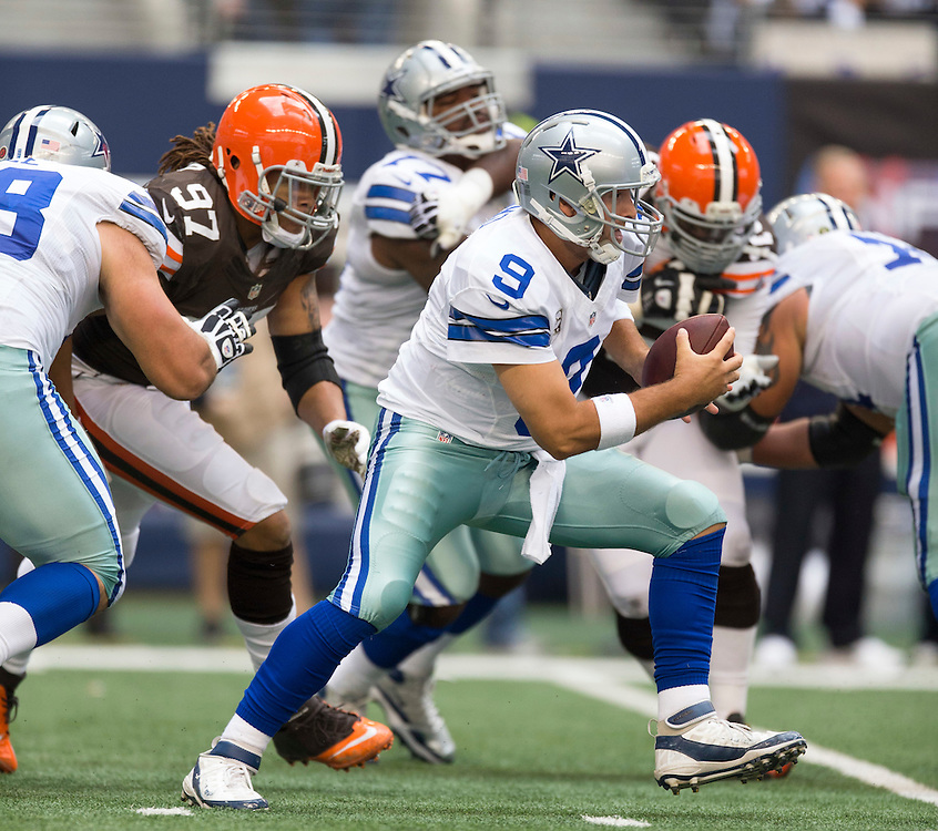 ARLINGTON, TX - NOVEMBER 18:  Tony Romo #9 of the Dallas Cowboys scrambles during a game against the Cleveland Browns at Cowboys Stadium on November 18, 2012 in Arlington, Texas.  The Cowboys defeated the Browns 23-20.  (Photo by Wesley Hitt/Getty Images) *** Local Caption *** Tony Romo