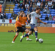 Lawrie Wilson takes the ball away from ex team mate Adam Le Fondre during the Sky Bet Championship match between Bolton Wanderers and Wolverhampton Wanderers at the Macron Stadium, Bolton, England on 12 September 2015. Photo by Mark Pollitt.