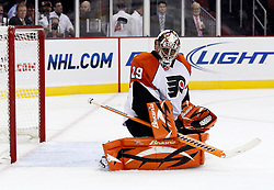Oct 3, 2009; Newark, NJ, USA; Philadelphia Flyers goalie Ray Emery (29) makes a save during the second period of his game against the New Jersey Devils at the Prudential Center.