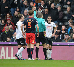 Derby County's Stephen Warnock is shown a red card after his second yellow card. - Photo mandatory by-line: Alex James/JMP - Mobile: 07966 386802 - 14/02/2015 - SPORT - Football - Derby  - ipro stadium - Derby County v Reading - FA Cup - Fifth Round