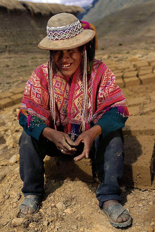 Quechua Indian<br />Unmarried Men wear beaded hats in this region<br />Near Cusco.<br />Andes.  PERU.  South America