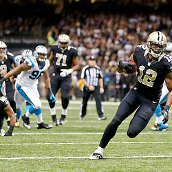Dec 8, 2013; New Orleans, LA, USA; New Orleans Saints wide receiver Marques Colston (12) scores a touchdown against the Carolina Panthers during the second half of a game at Mercedes-Benz Superdome. Mandatory Credit: Derick E. Hingle-USA TODAY Sports
