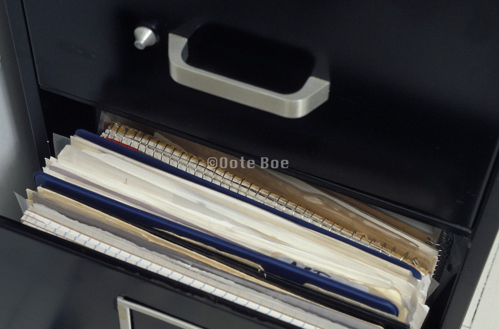 documents inside metal filing cabinet