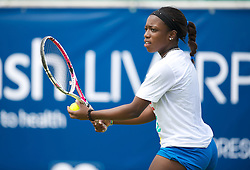 LIVERPOOL, ENGLAND - Wednesday, June 20, 2012: Sachia Vickery (USA) plays an exhibition women's doubles match during a kids' day at the Medicash Liverpool International Tennis Tournament at Calderstones Park. (Pic by David Rawcliffe/Propaganda)
