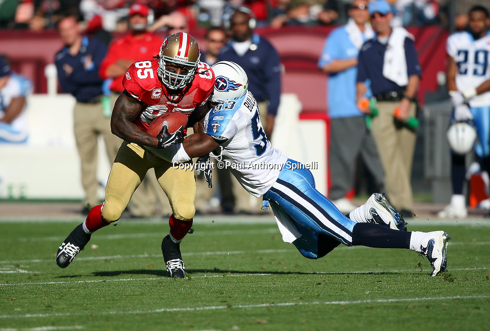 San Francisco 49ers tight end Vernon Davis (85) makes a cut while trying to avoid a diving tackle by Tennessee Titans linebacker Keith Bulluck (53) during the NFL football game against the Tennessee Titans, November 8, 2009 in San Francisco, California. The Titans won the game 34-27. (©Paul Anthony Spinelli)